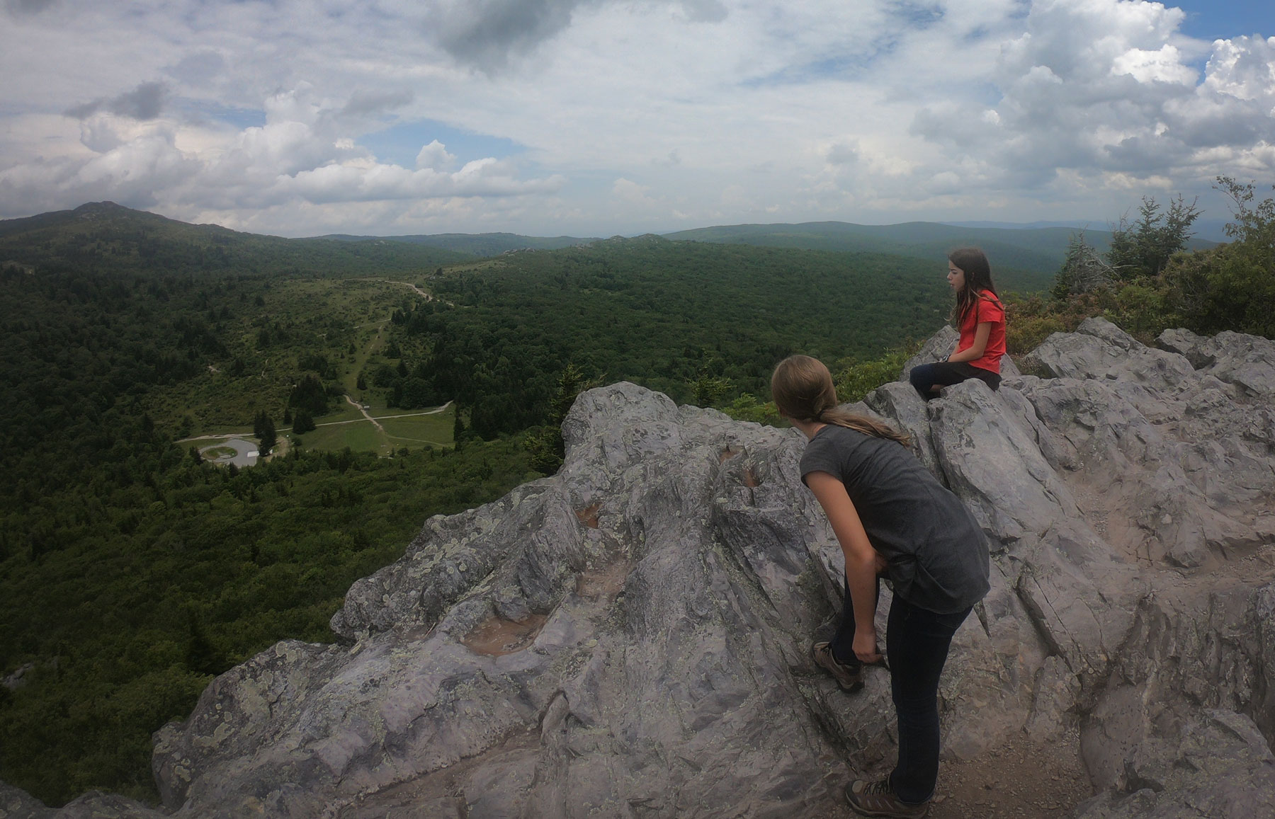 Two kids looking over Pinnacle Summit while camping in Grayson Highlands State Park, Virginia