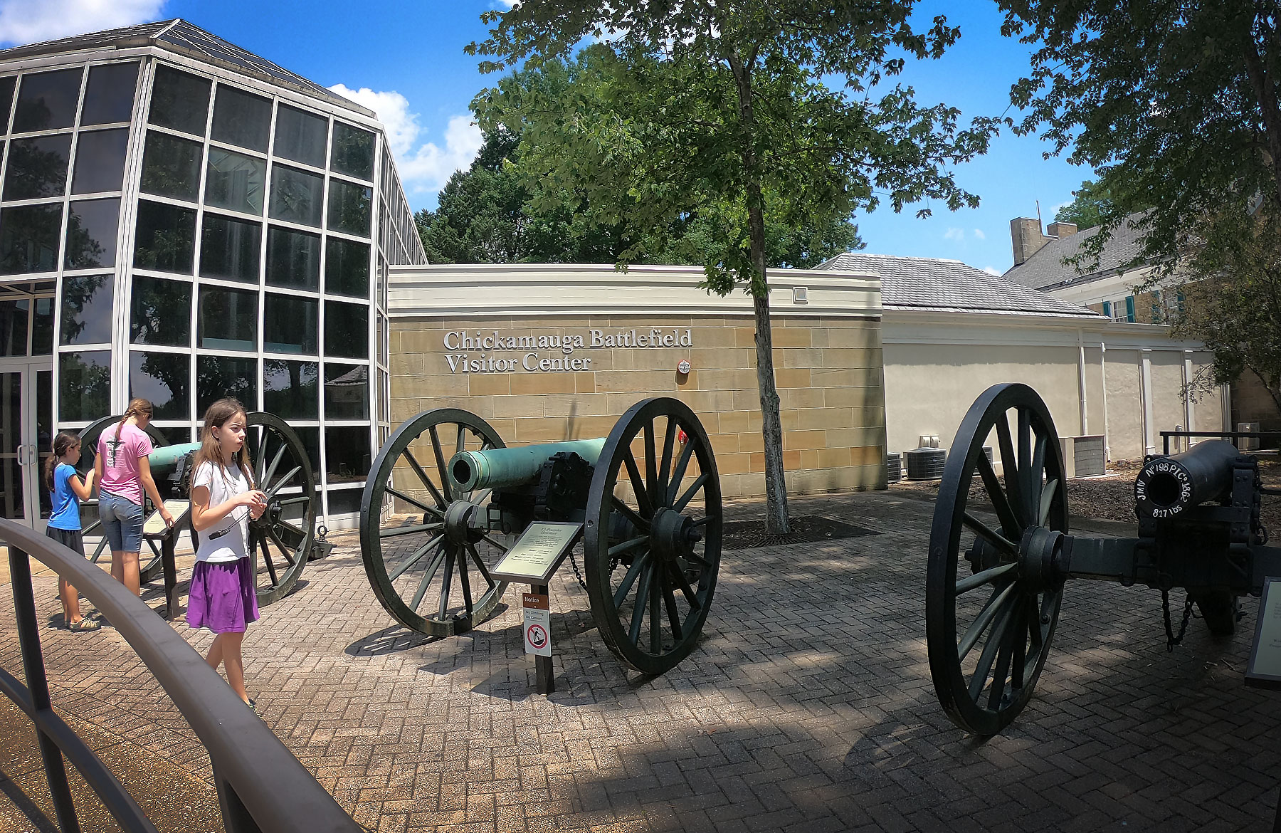 Three girls near cannons outside the Chickamauga and Chattanooga National Military Park, Georgia Visitor Center, Georgia