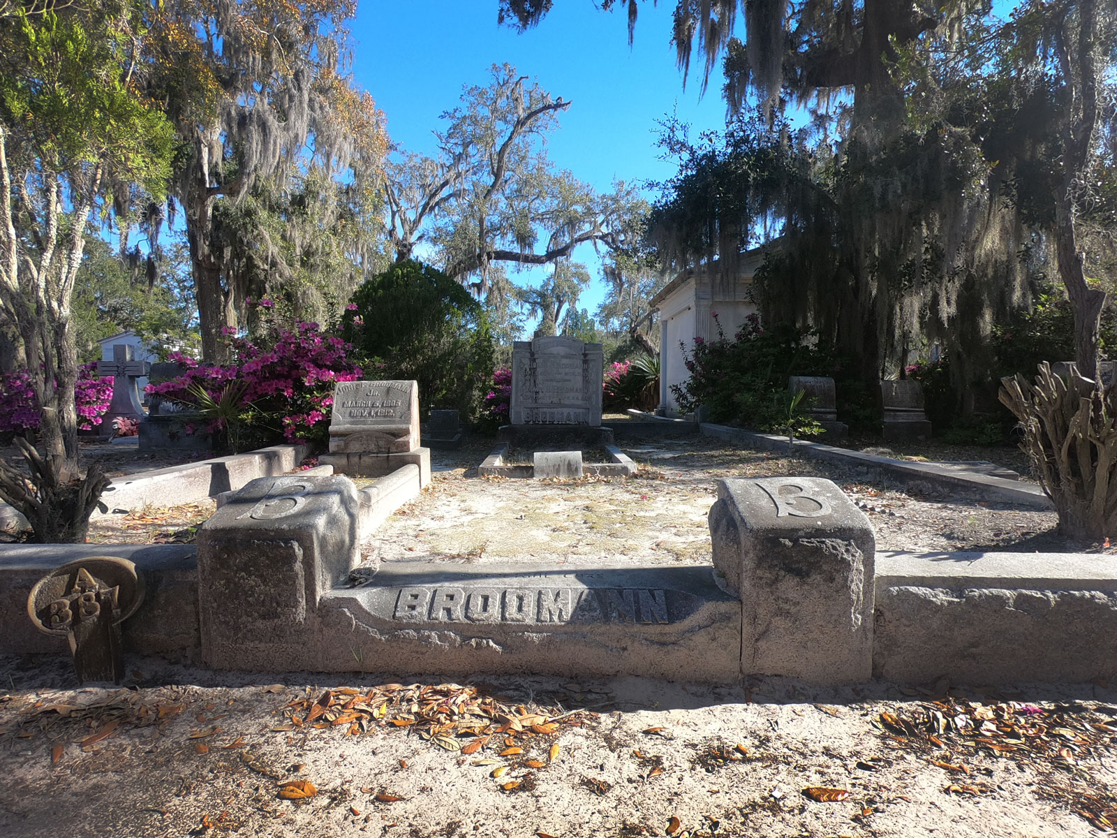 Gravestones with flowering azaleas and live oaks in Bonaventure Cemetery, Savannah, Georgia