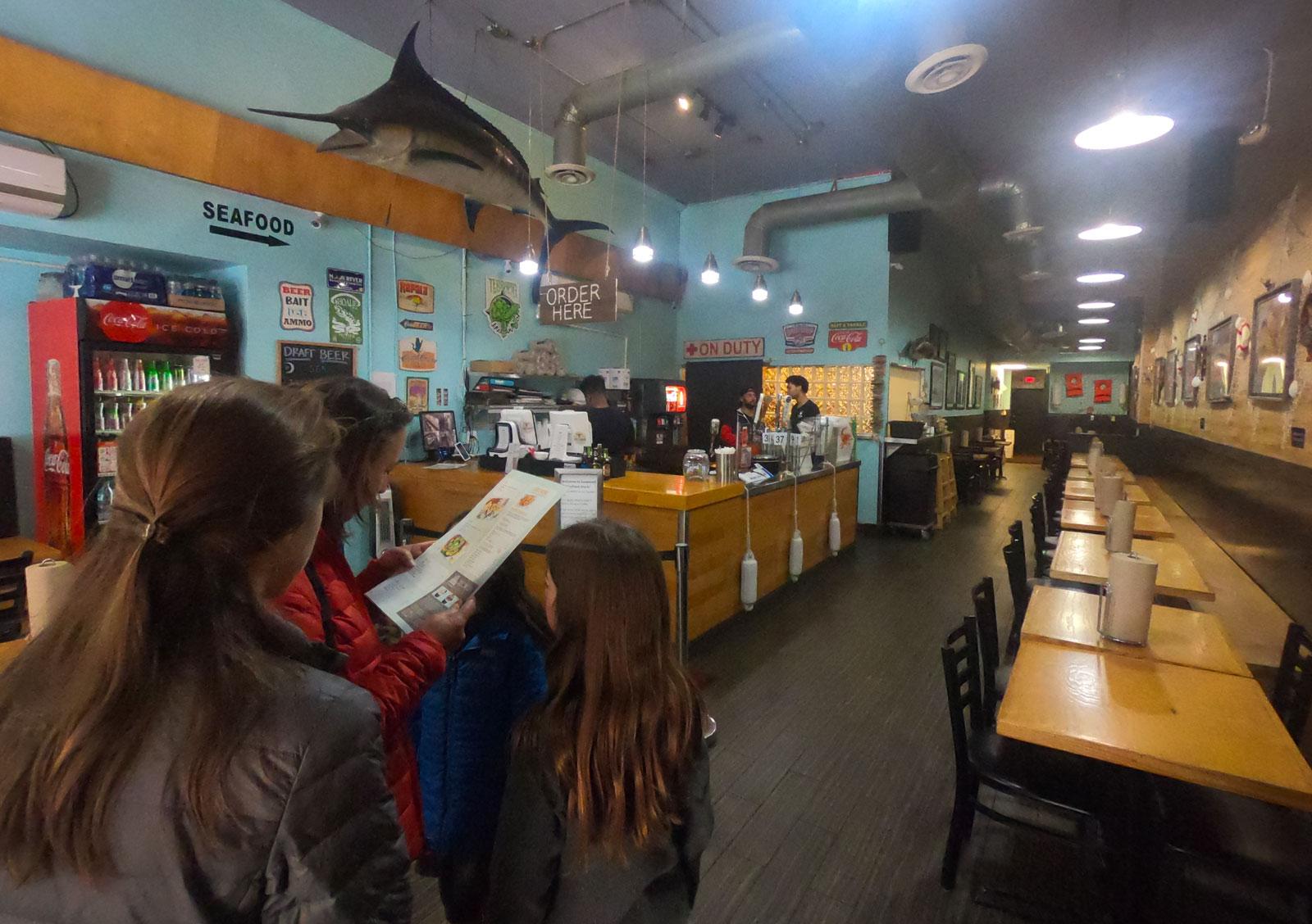 Family looking at Savannah Seafood Shack menu