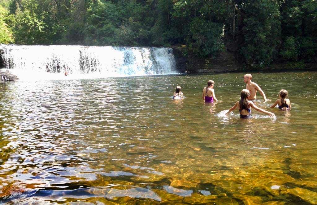 Kids swimming at Hooker Falls, Dupont State Recreational Forest, North Carolina