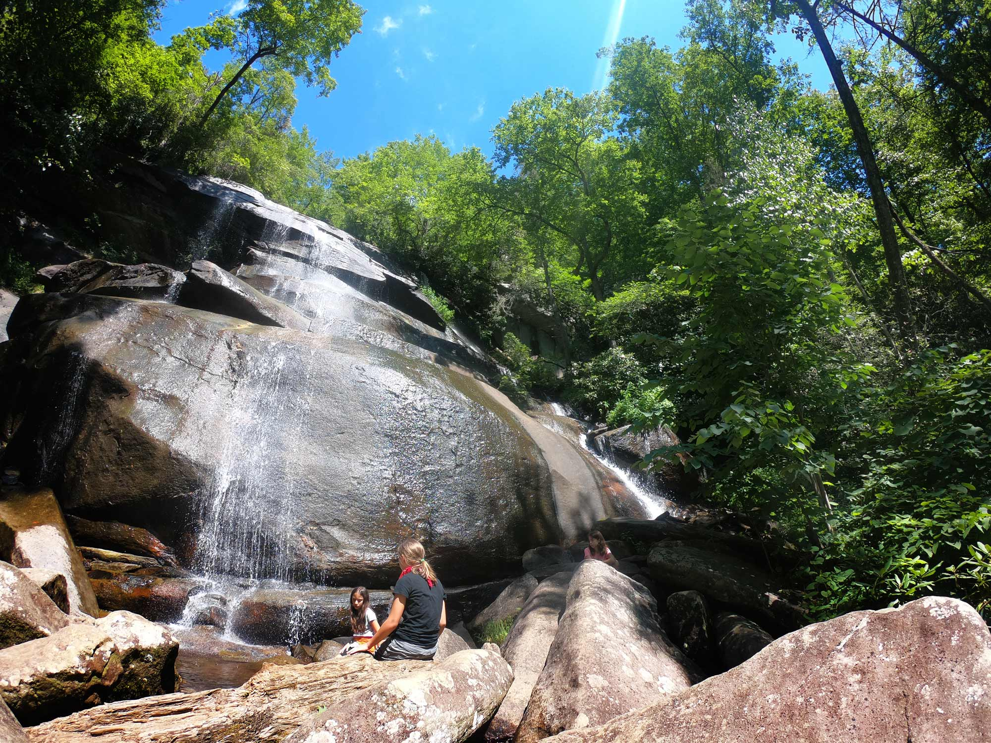 Two girls wading at the base of Daniel Ridge Falls in Pisgah National Forest, North Carolina