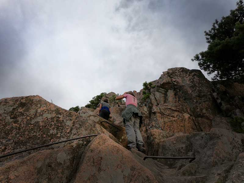 Two hikers climbing the iron rungs on the Beehive Trail, Acadia National Park, Maine