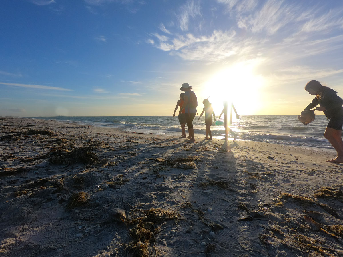 Mother and four daughters looking for seashells at sunset on Sanibel Island, Florida while camping at Periwinkle Park
