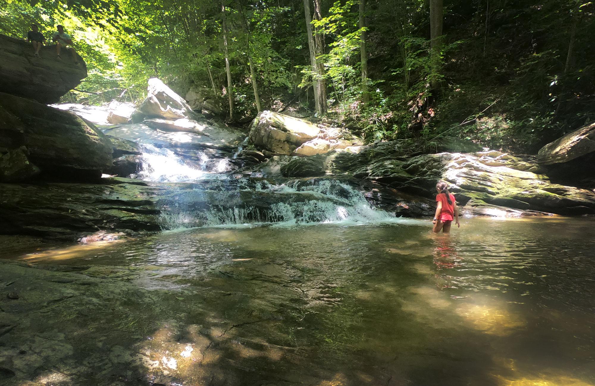Girl wading in the Crab Orchard Falls, near Blue Ridge Parkway, North Carolina