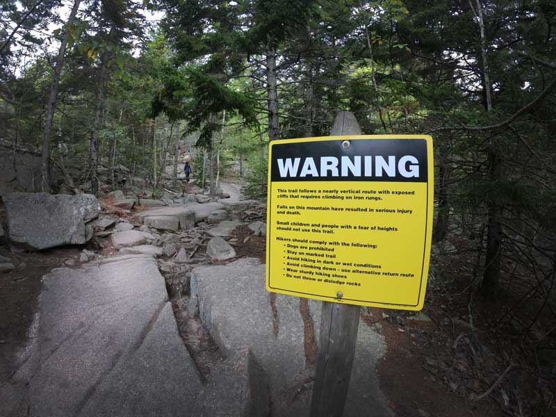 Warning sign at the start of the Beehive Trail, Acadia National Park, Maine