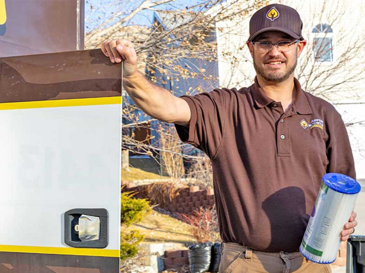 Lance Ball Of Aspen Mountain Plumbing Getting Ready To Service A Customer With A Water Softener.