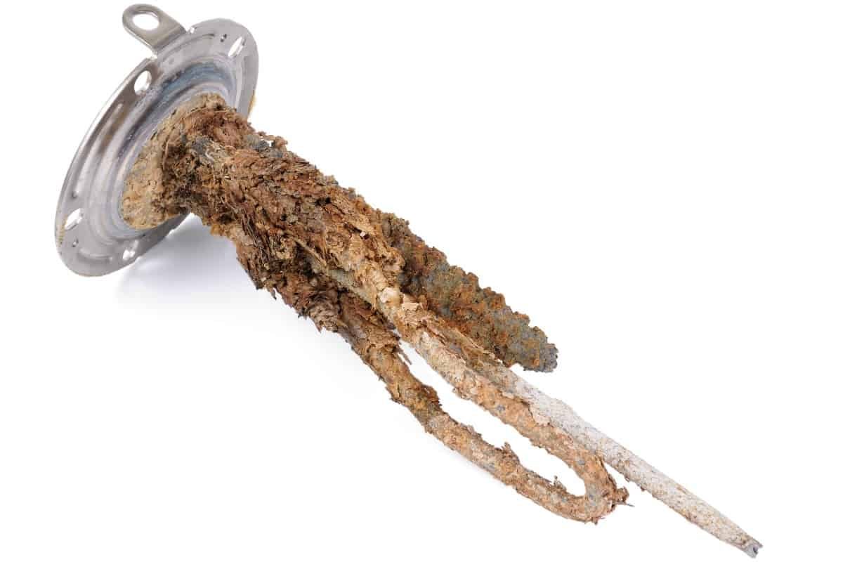 A heating element from a water heater with scum and rust - Aspen Mountain Plumbing