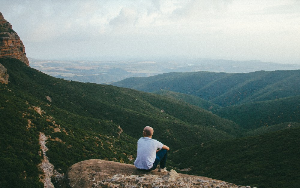 a person on the edge of the mountain