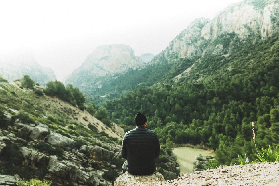 a man sitting on a mountain