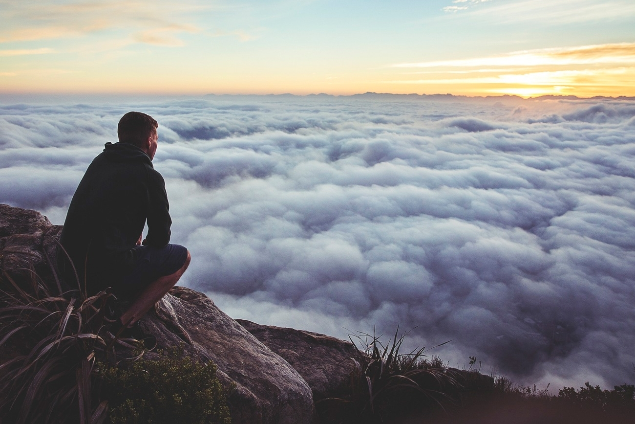 20151208175408-man-top-mountain-clouds-thinking-meditating-peace-relaxation-peak-sunset-horizon