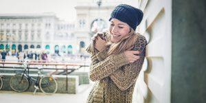 Beautiful woman enjoying winter in the city