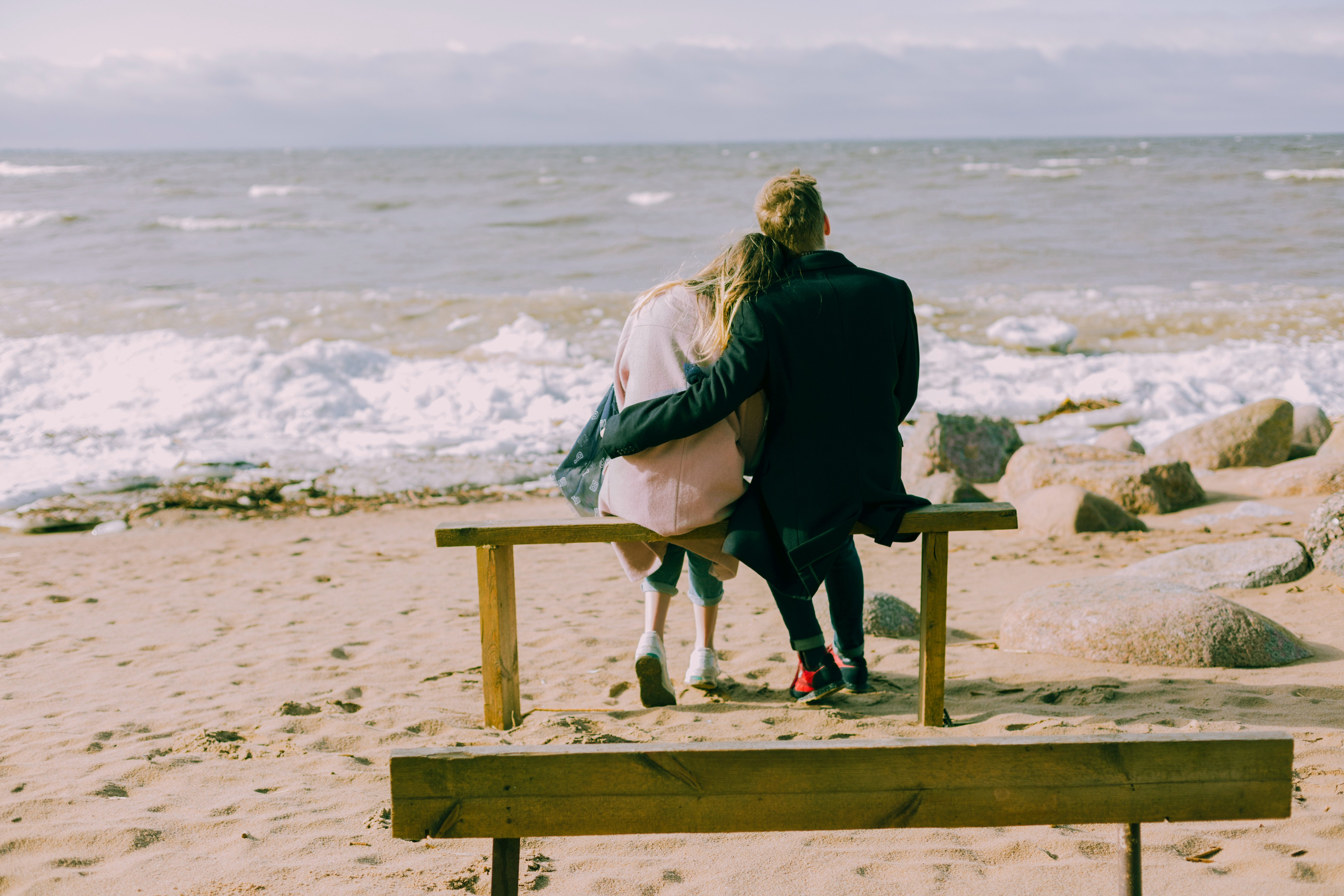 A couple hugging at the beach.