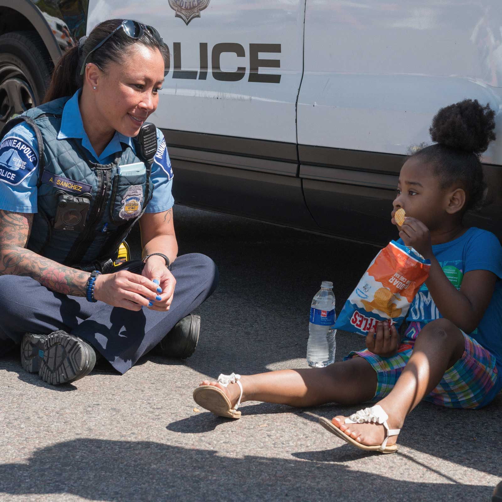 Police officer helping a young girl