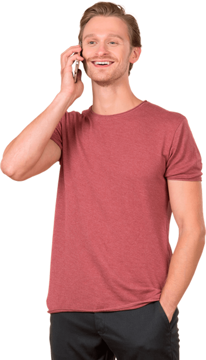 A man in a red shirt on the phone with Business Techs IT Support