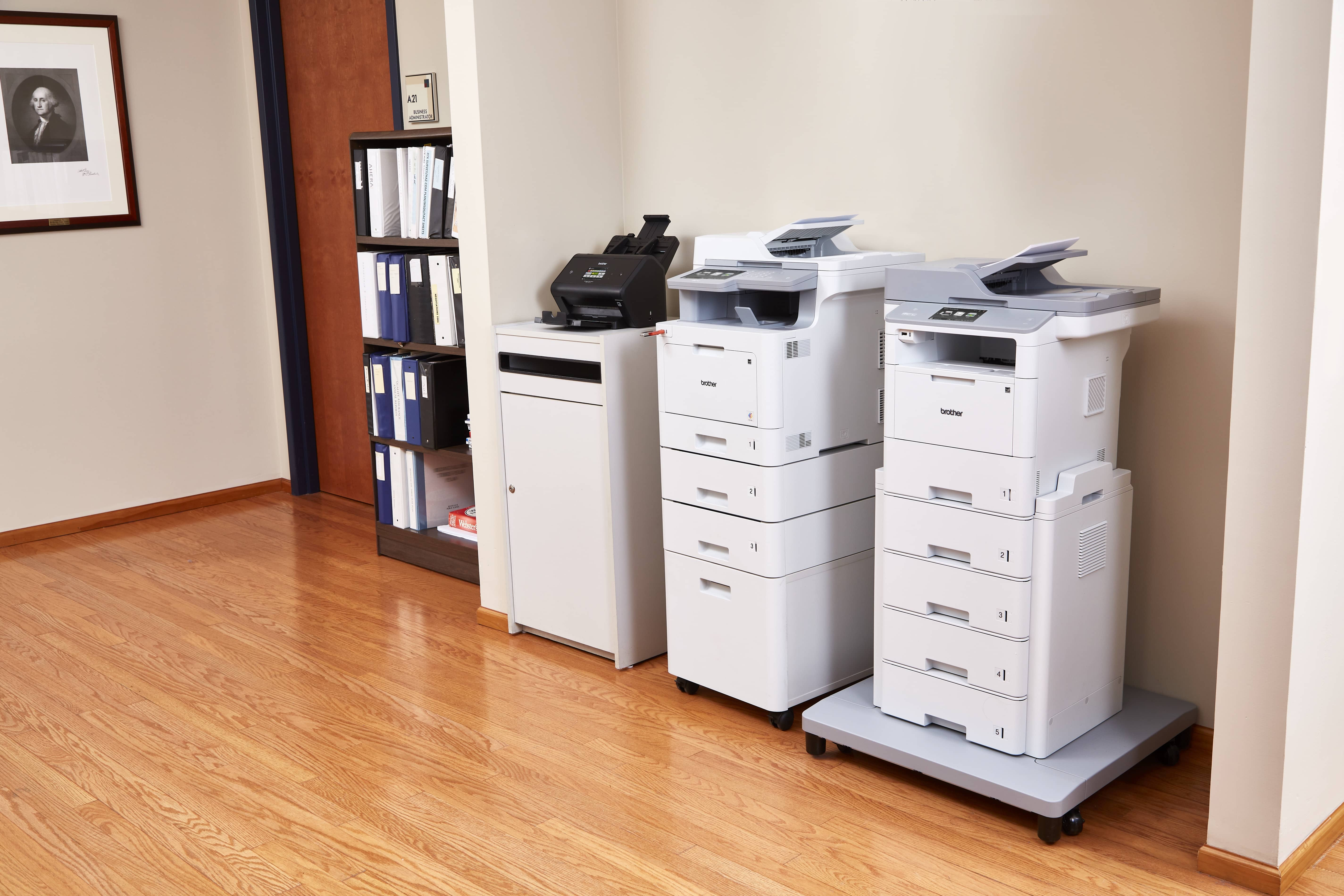 Brother printers, copiers, and MFP's in an office space.