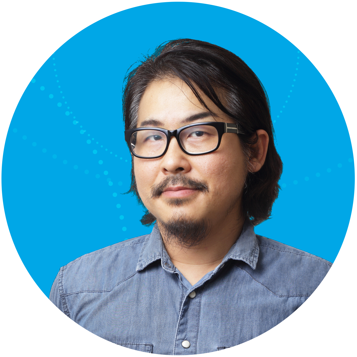 Content Asian-American man with a blue buttoned up shirt in front of a light blue background