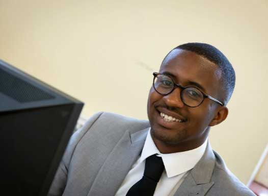 African American man smiling at the camera in a business suit