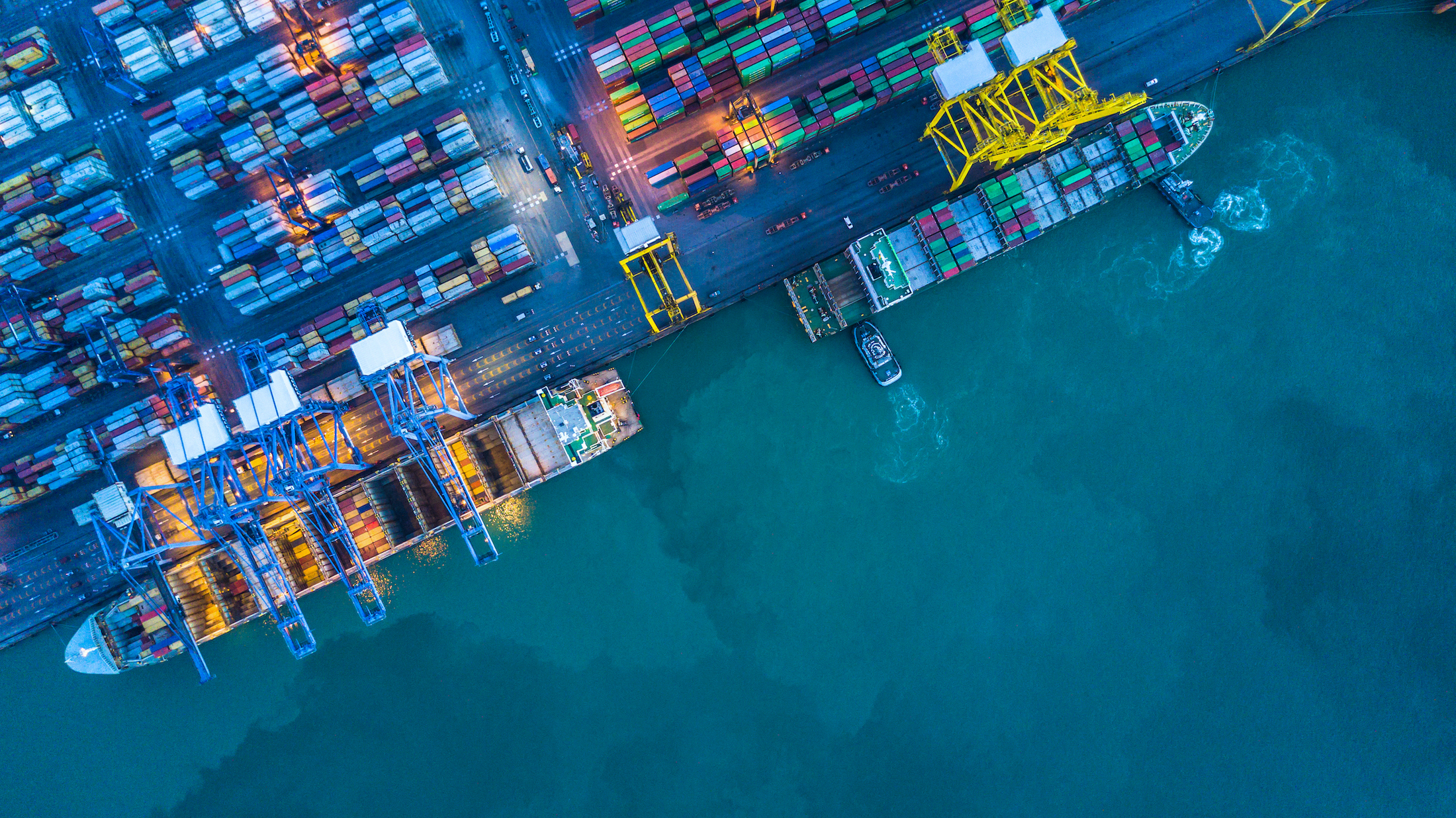 Shipping containers on dock surrounded by sea