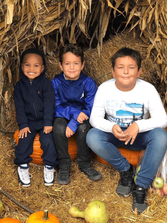 Children sitting on haybail