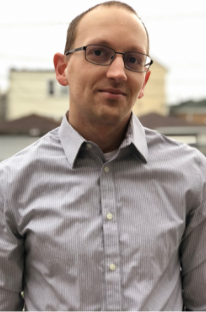 Male pastor in button up with glasses