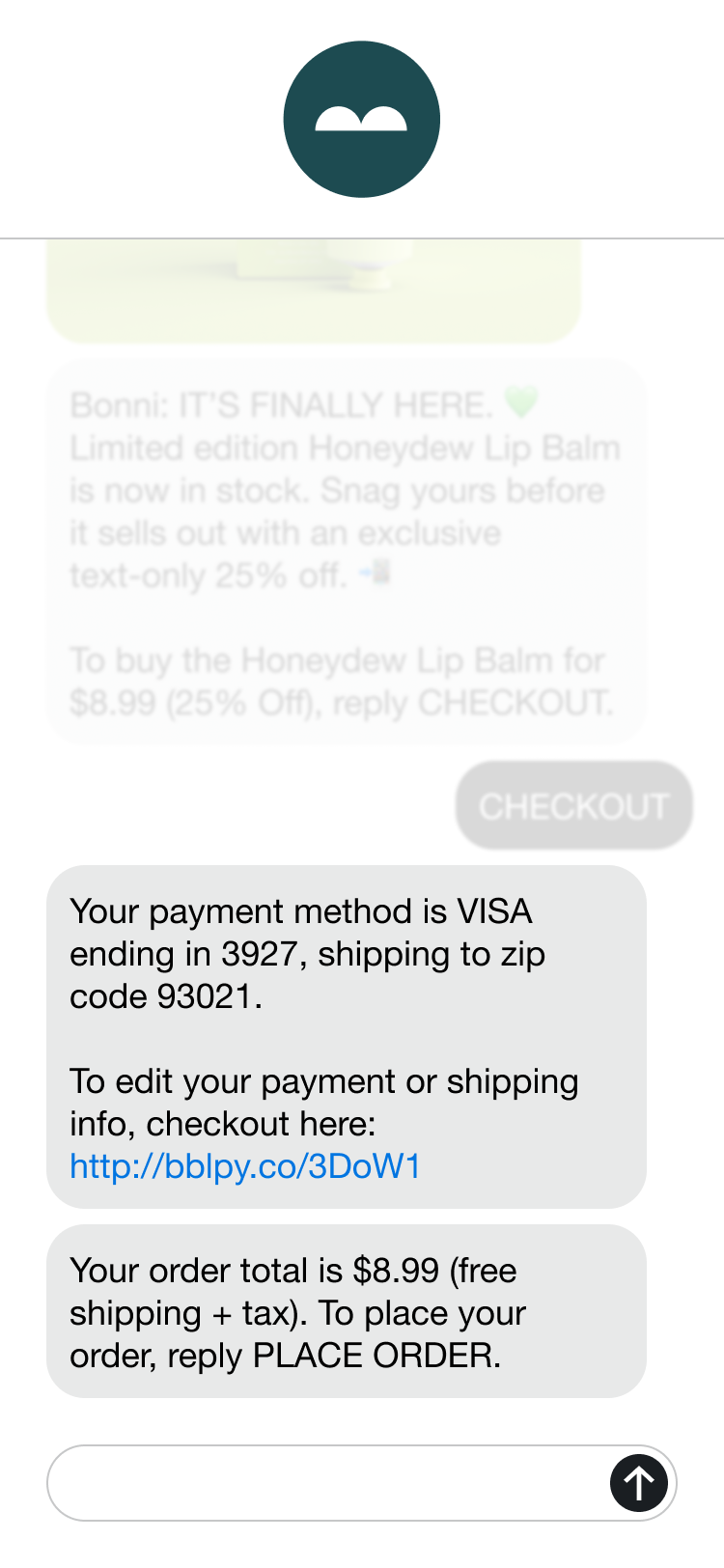 A phone showing a shipping and billing confirmation message