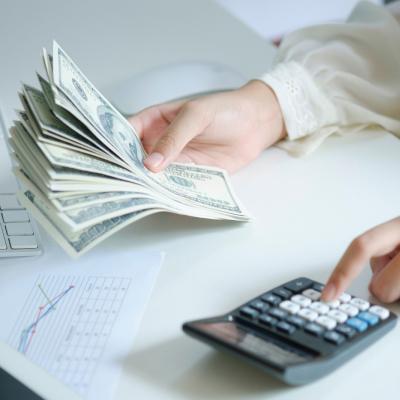 Businessman computes budget for company incorporation