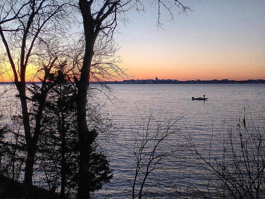 Fisherman at sunset on Lake Monona