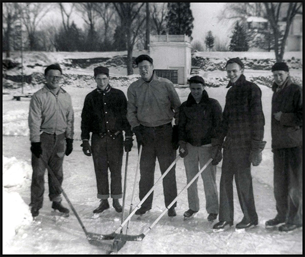 Residents of San Damiano enjoying a game of hockey on Lake Monona.