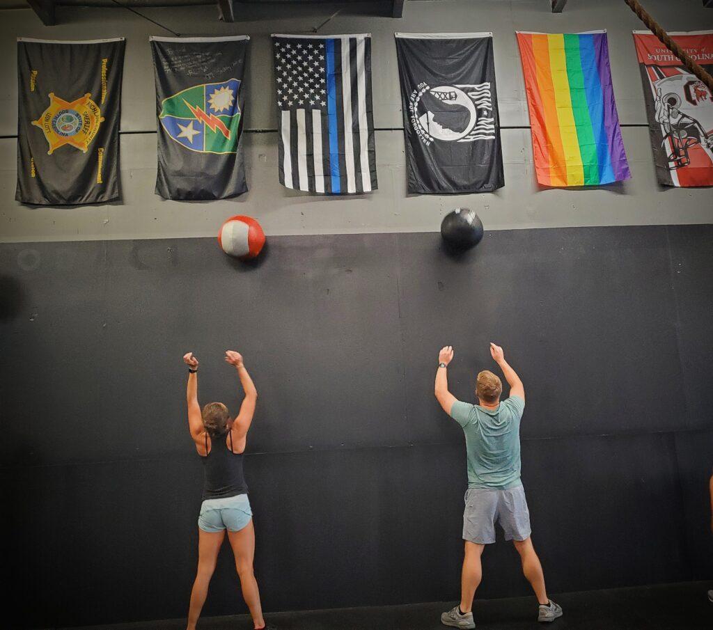 CrossFit Soda City's Coach Elise and Member Ryan B.
