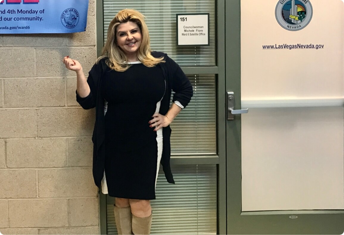 Michele Fiore posing for a picture outside her office.