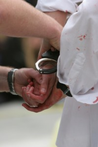 man in handcuffs Chicago Criminal Defense Lawyer
