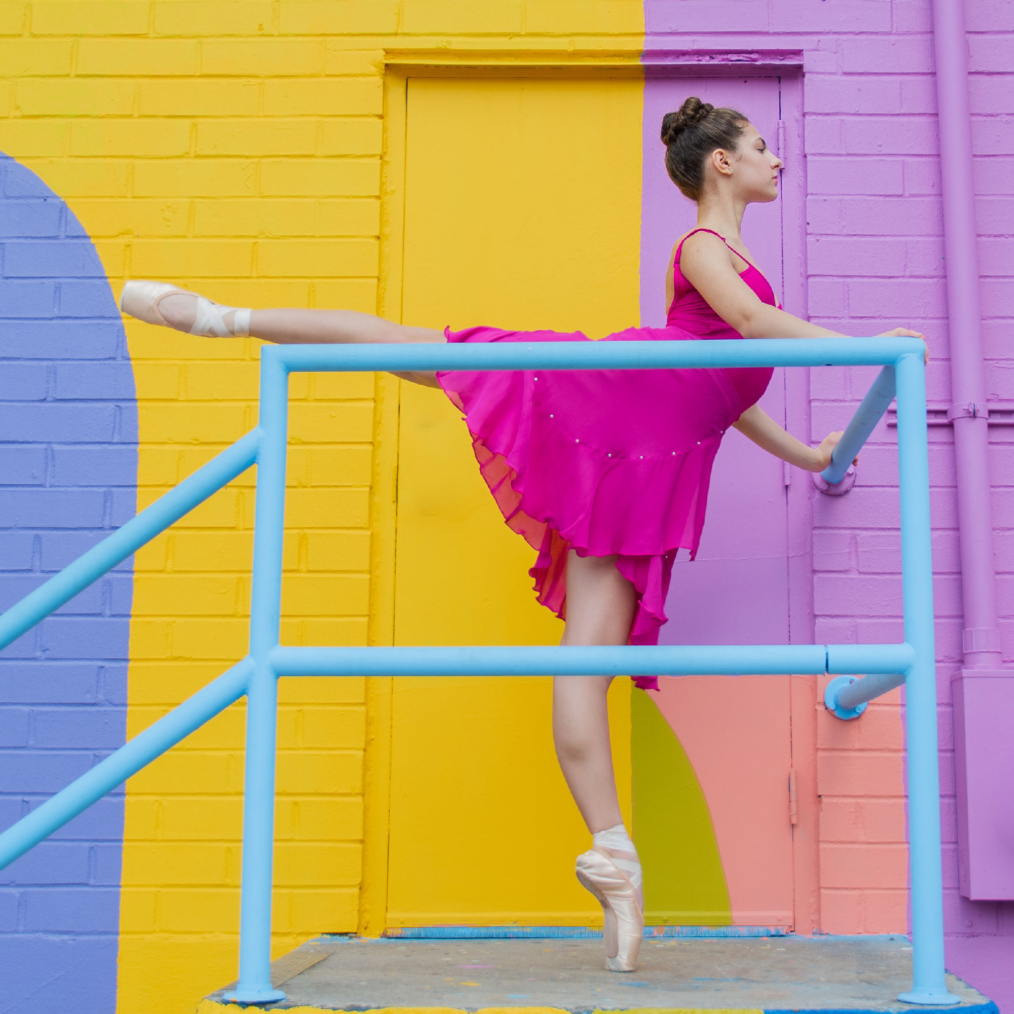 Summer Intensive student poses in arabesque outdoors