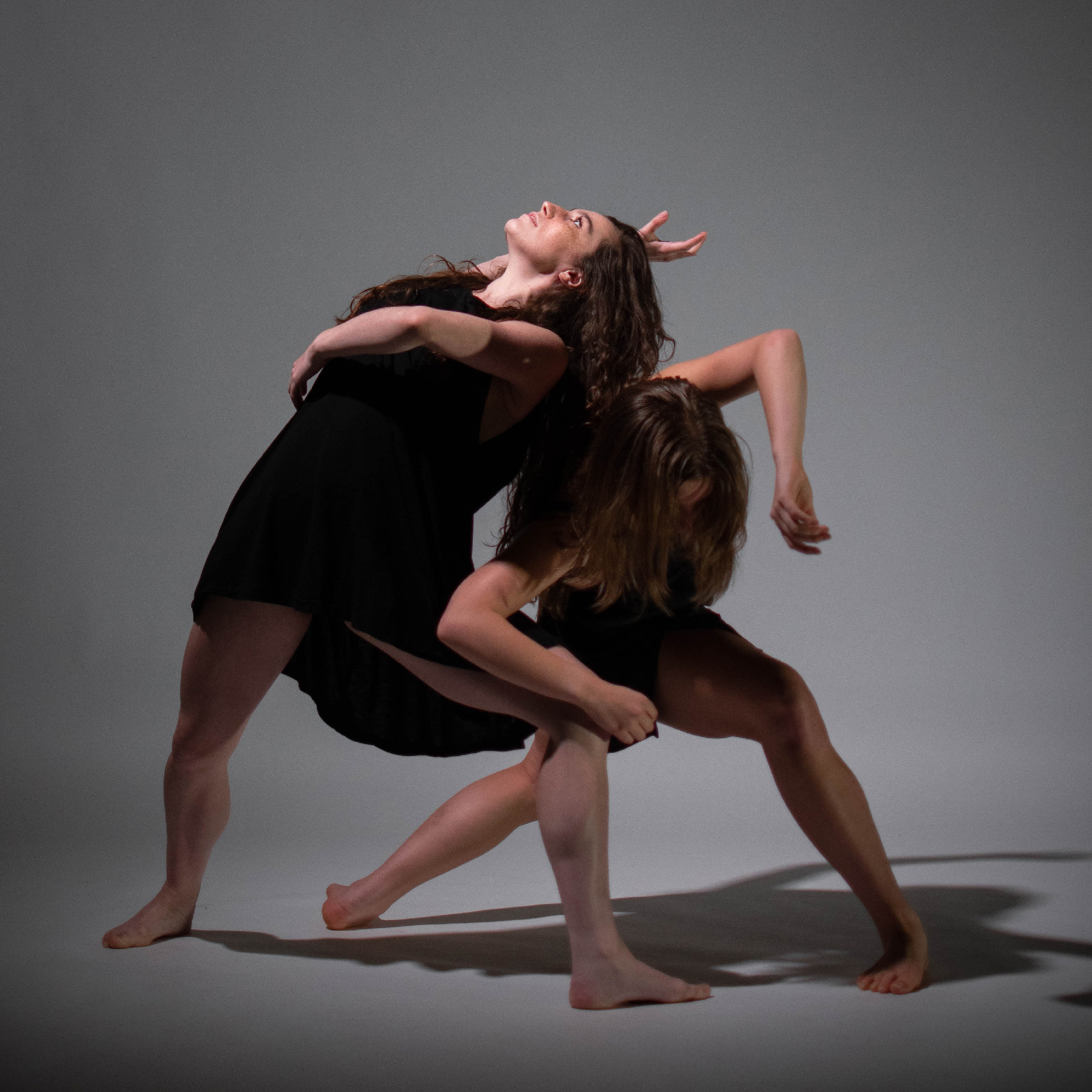 Two dancers intertwined