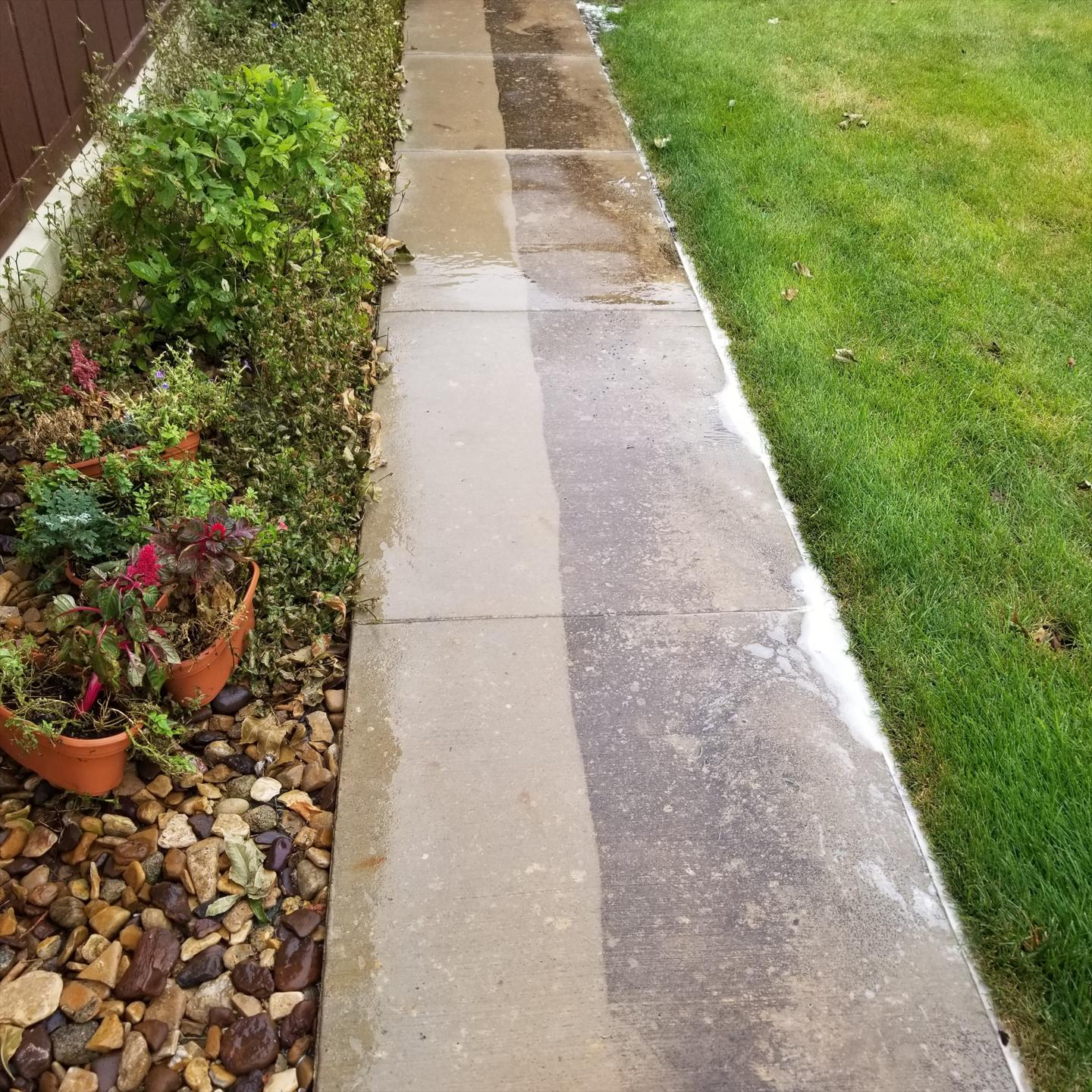 A cement walkway clean and looking like new.