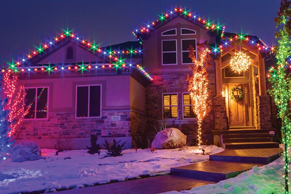A multi-colored lighting on a house.