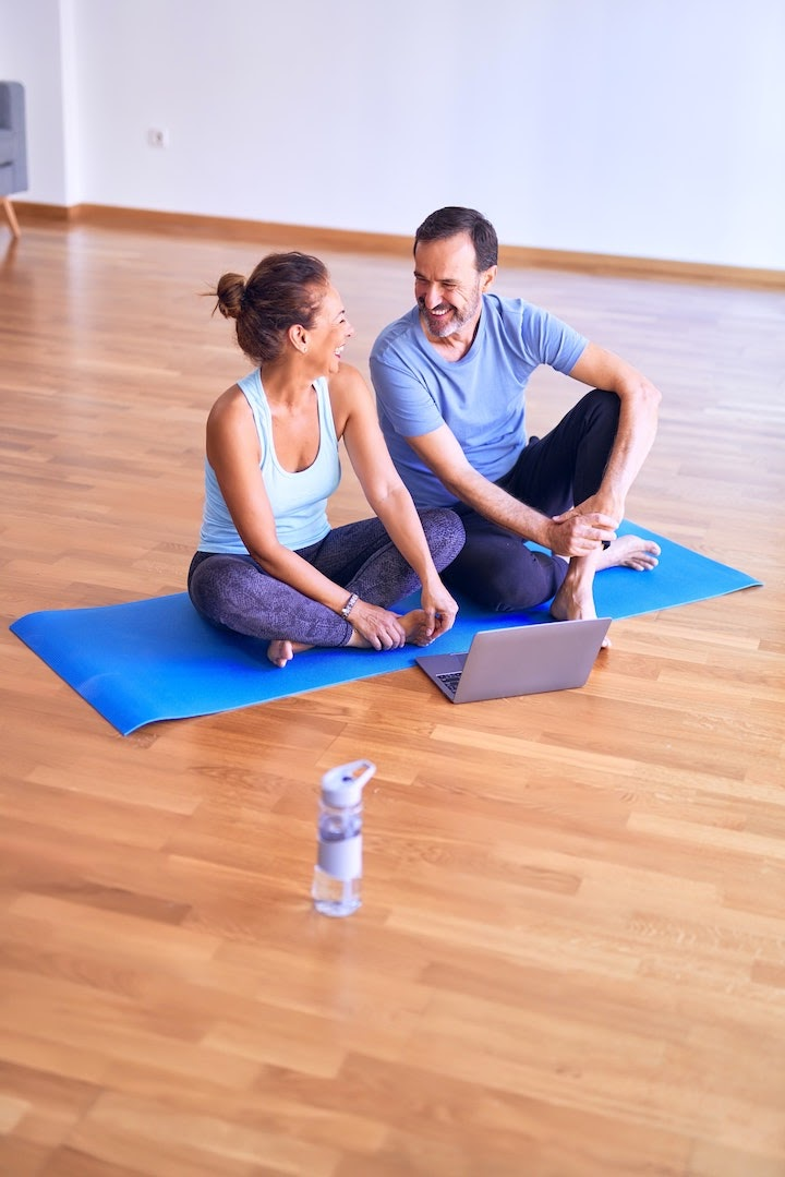 man and woman sitting on mat