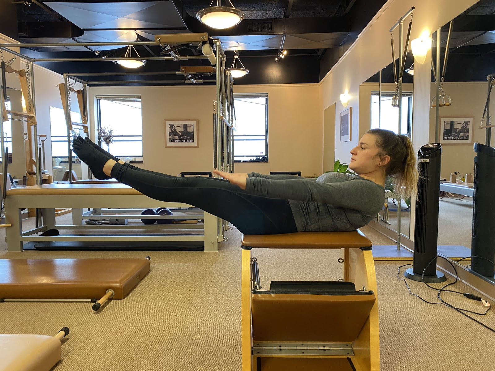 client exercising on equipment