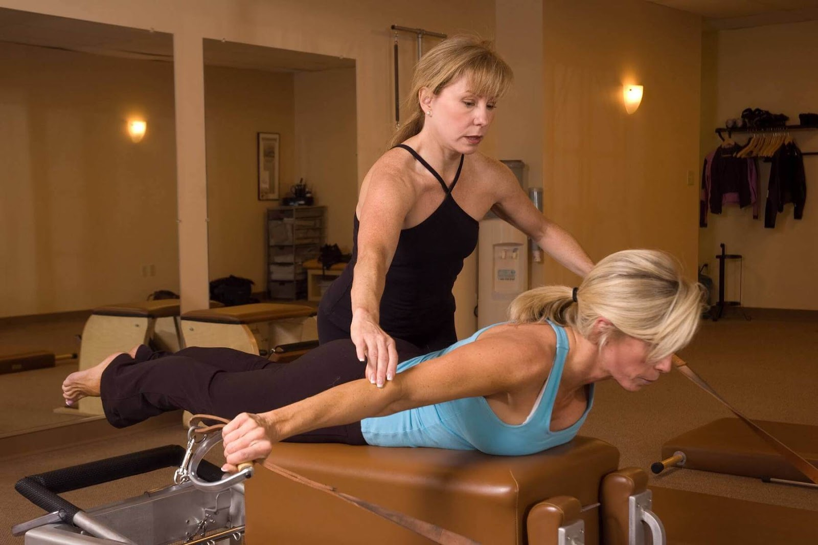 Pilates instructor and student