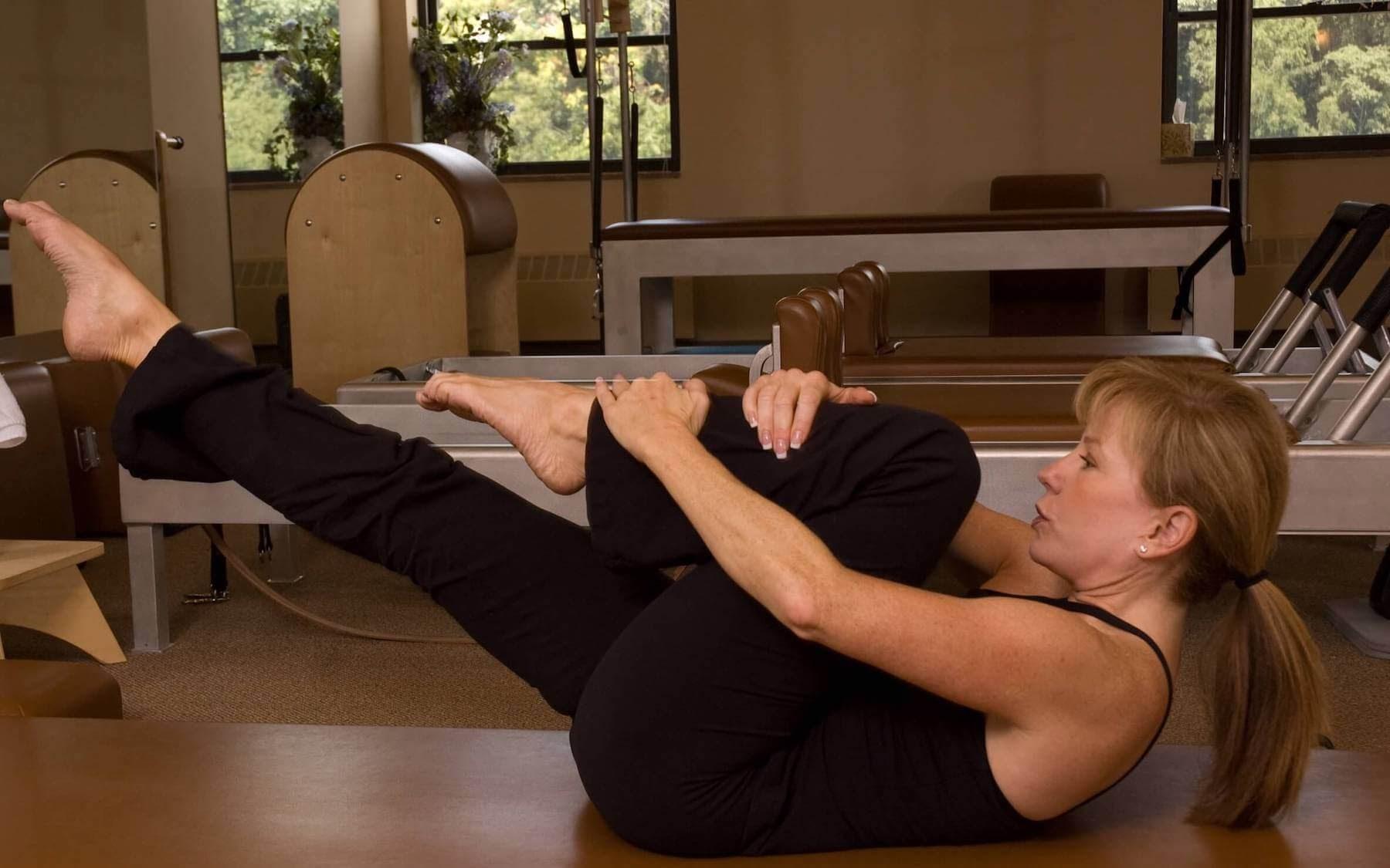 woman performing Pilates