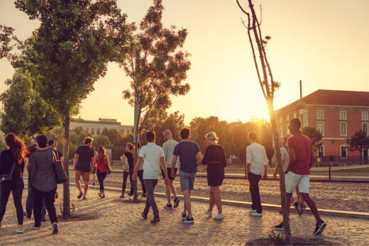 A team walking in the city during the sunset.