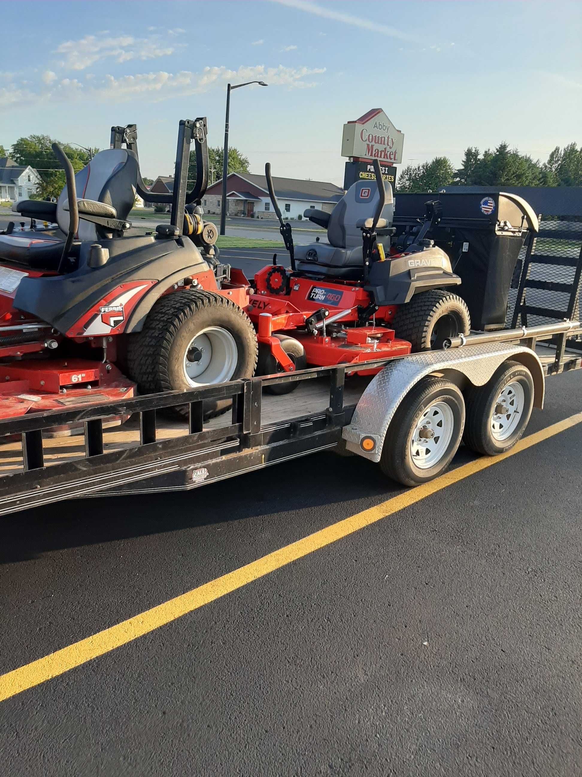 Closeup of Advanced Lawn Care trailer with mowing equipment