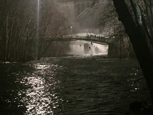 Stuntmen hang out by the bridge in the shadow of the dam filming the climax to the chase scene