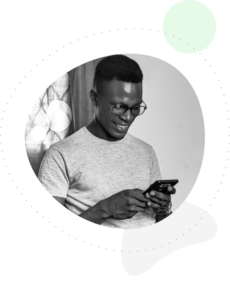 A man looking down at his phone and smiling