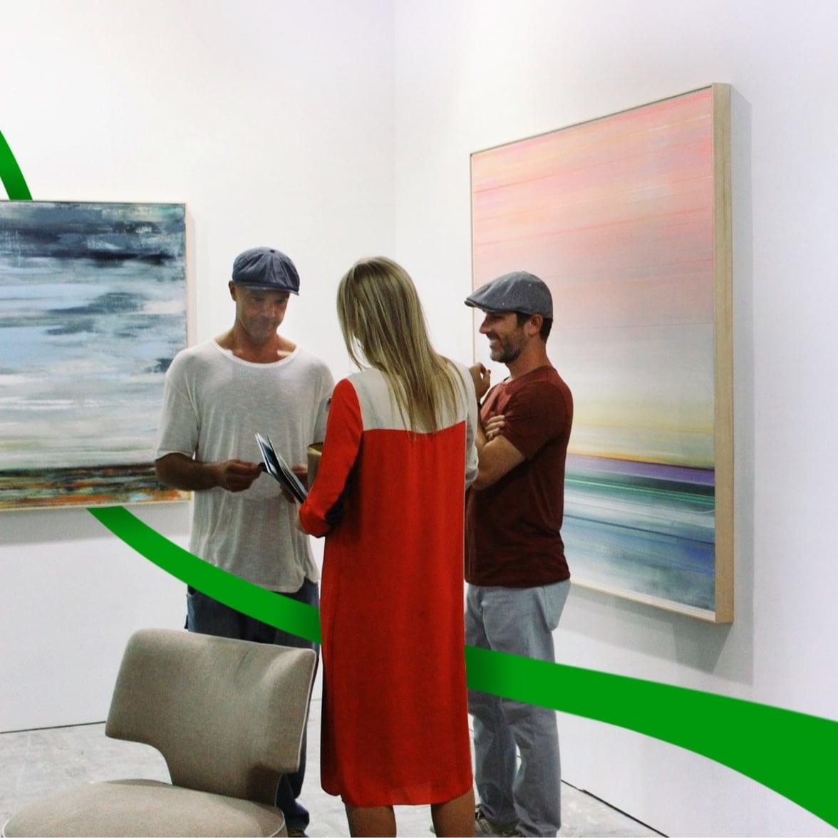 Woman showing two men art for AppraisalSoft art appraisal
