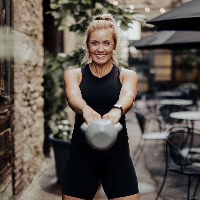 Holly J using kettle bell to workout