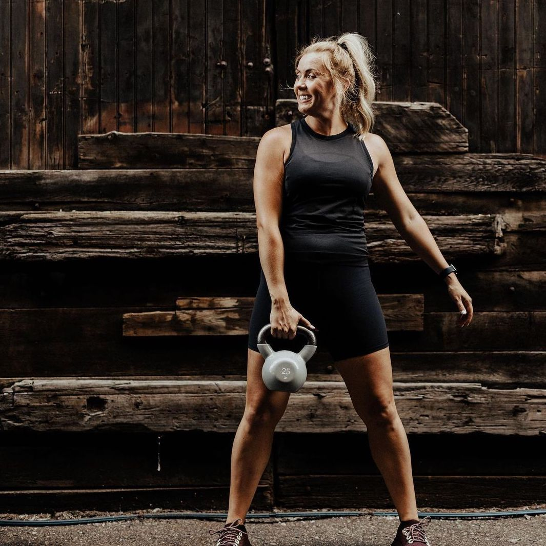 Holly J exercising with kettle bell