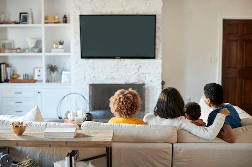 Family enjoying the newly wall mounted TV