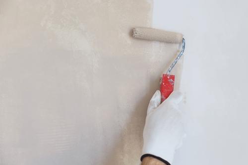 Applying a fresh coat on an interior wall