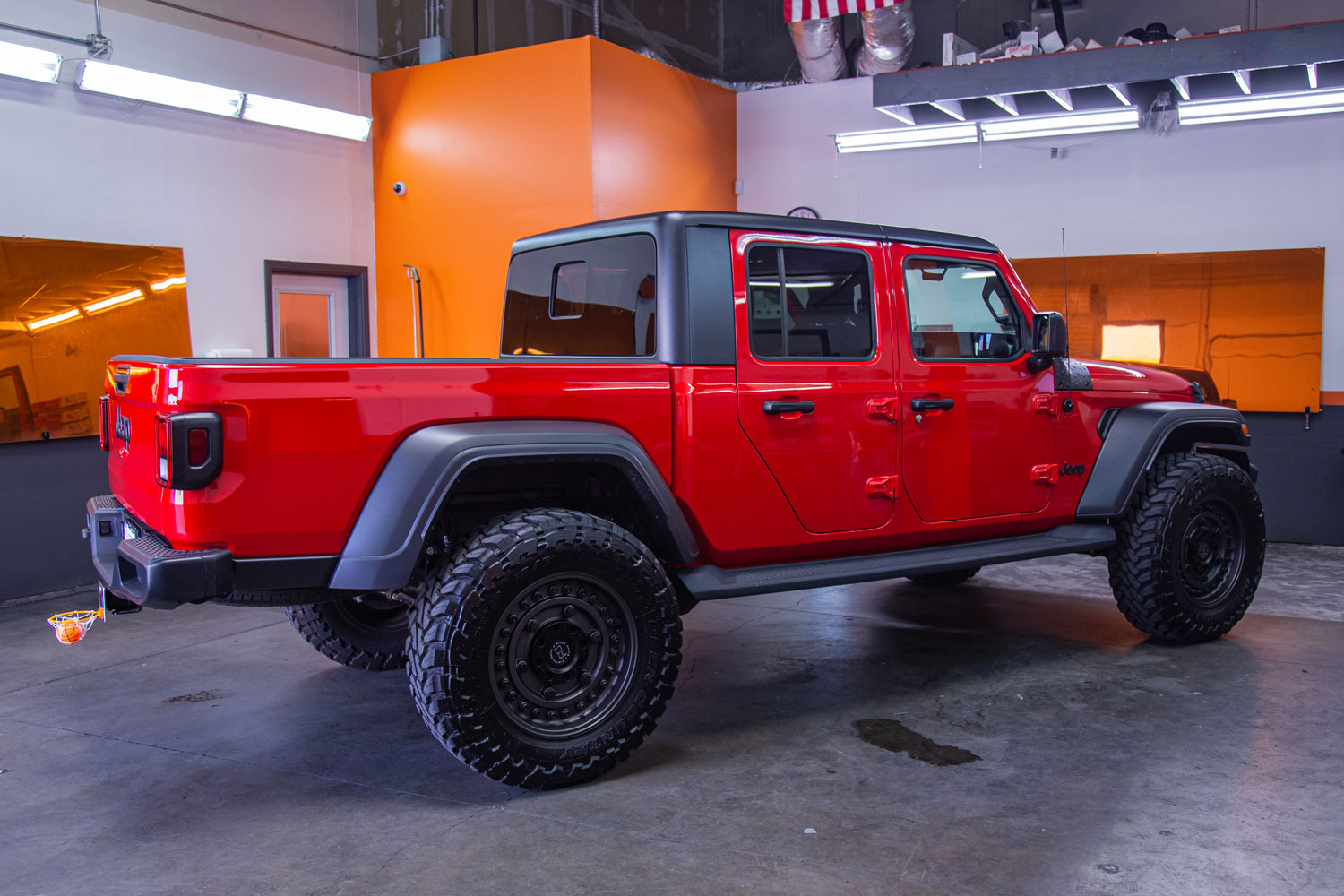 A red luxurious Jeep with nice tinted windows.